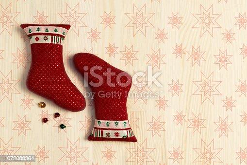 858960516 istock photo Christmas decoration - socks 1072088364