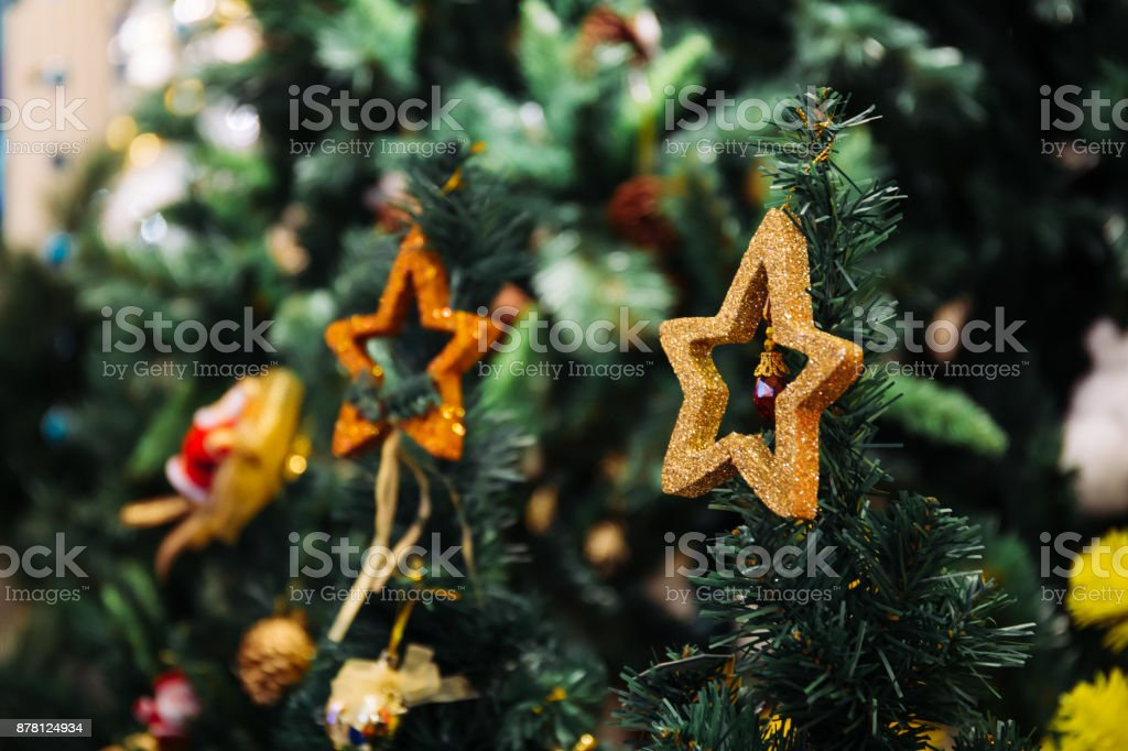 Christmas decoration stars on the top of Christmas tree with copy space stock photo