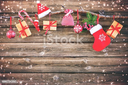 858960516istockphoto Christmas decoration stocking and gift boxes 686234350