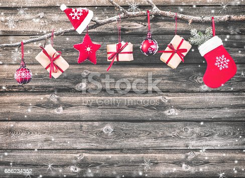 858960516istockphoto Christmas decoration stocking and gift boxes 686234352