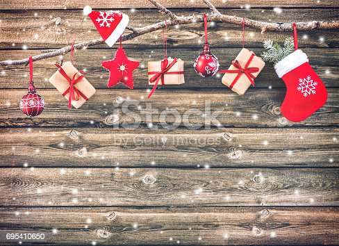 858960516istockphoto Christmas decoration stocking and gift boxes 695410650