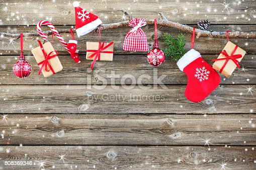 858960516istockphoto Christmas decoration stocking and gift boxes 808369346