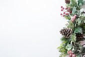 istock Christmas decoration, styled fir branches, pine cones, garland on white background. Top view with copy space. 1180843142