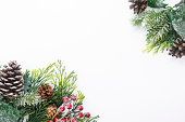 istock Christmas decoration, styled fir branches, pine cones, garland on white background. Top view with copy space. 1180843163
