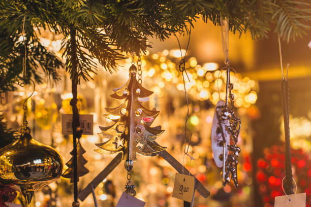 christmas decoration toy for sale on the market by night at european city stock photo