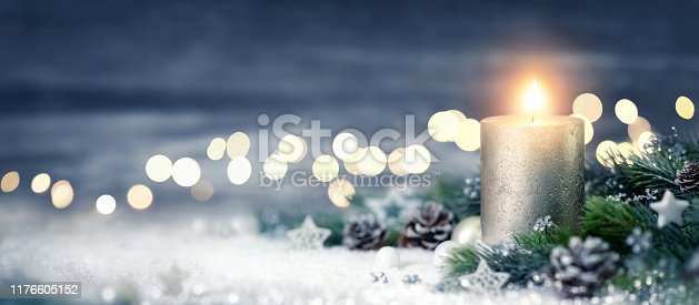 istock Christmas decoration with candle and lights 1176605152