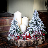 Beautiful table decoration for Christmas with red car Christmas trees and candles