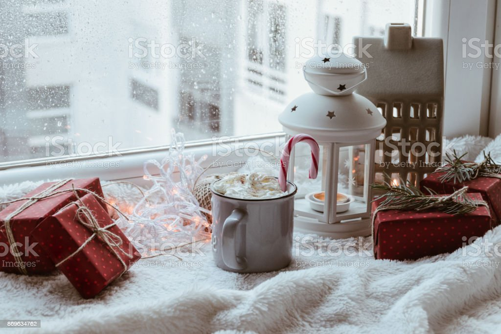 A Christmas decoration with Christmas presents, mug, decorative...