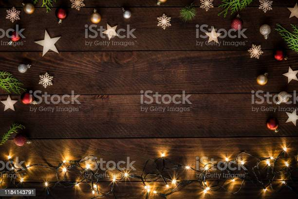Photo of Christmas decoration with copy space on a rustic wooden table