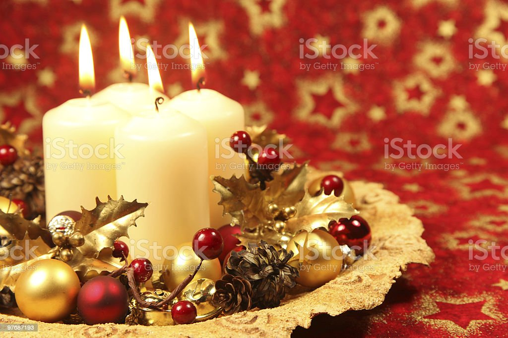 Christmas decoration with four candles royalty-free stock photo