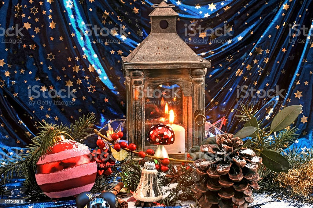 Christmas decoration with lantern and candle stock photo