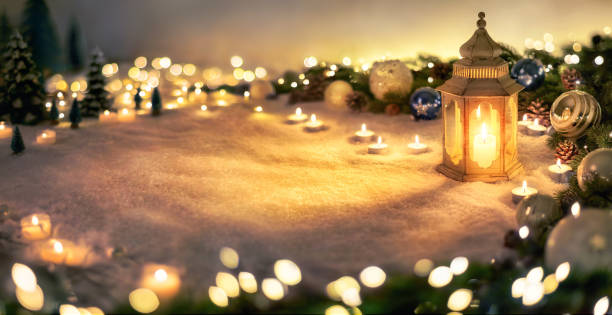 Christmas decoration with lantern and lights stock photo