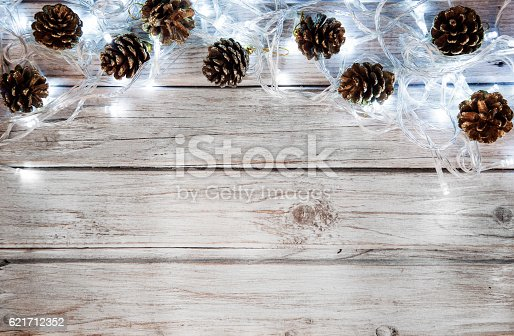 istock Christmas decoration with lights and pine cone 621712352