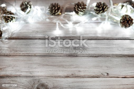 istock Christmas decoration with lights and pine cone 623377336