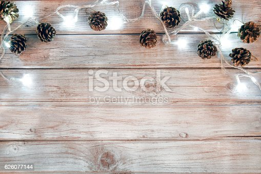 Christmas decoration with lights and pine cone