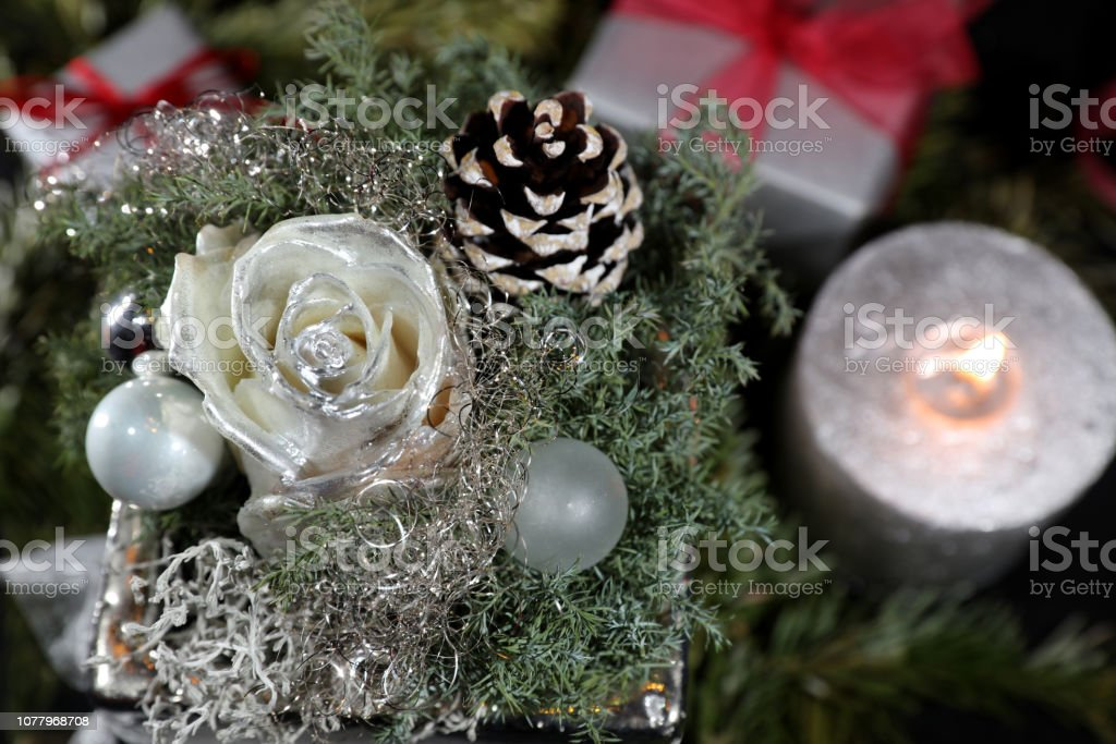 Christmas Decoration with Rose, Candle and Gifts on black background