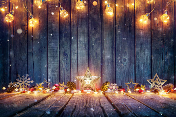 Christmas Decoration With Stars And String Lights On Rustic Wooden Table stock photo