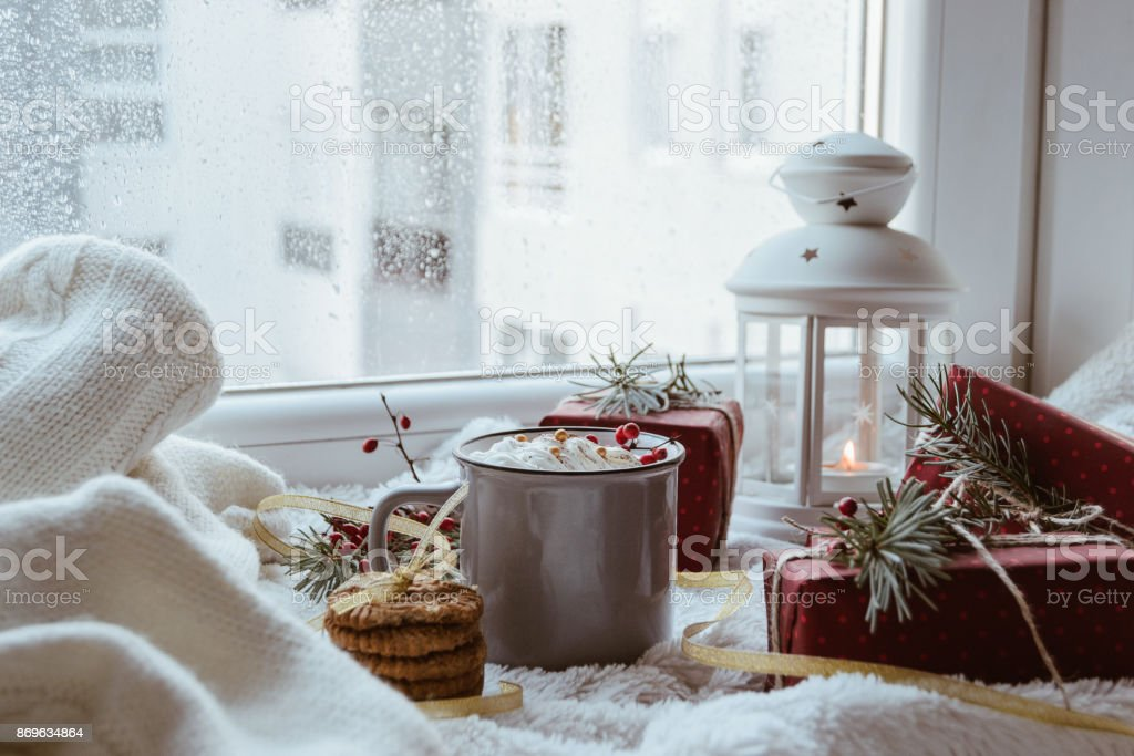 A Christmas decoration with three biscuits, mug, three presents,...