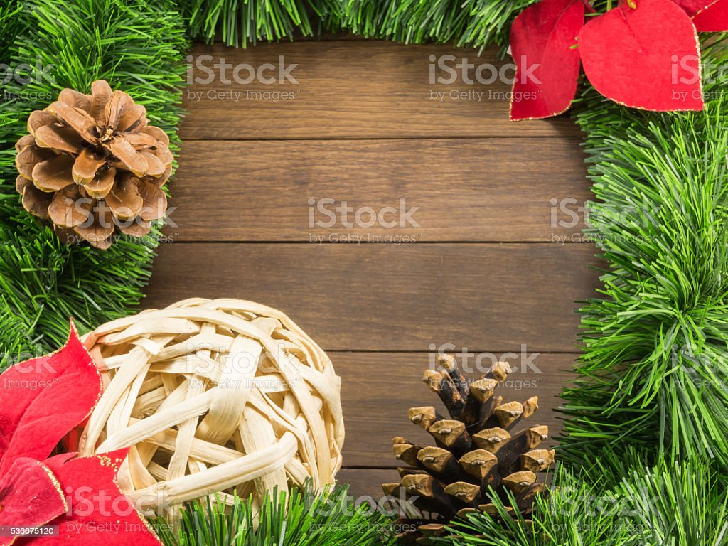 Christmas Decoration With Wicker Ball Pine Cones And Poinsettia Stock Download Image Now