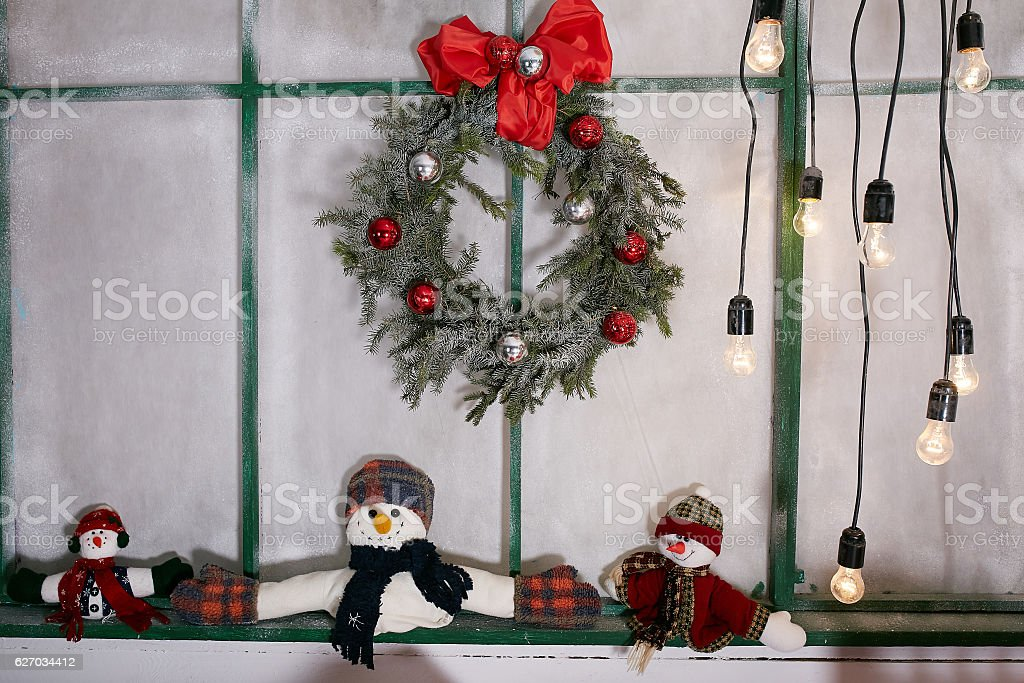 Christmas decoration with wreath and snowman stock photo