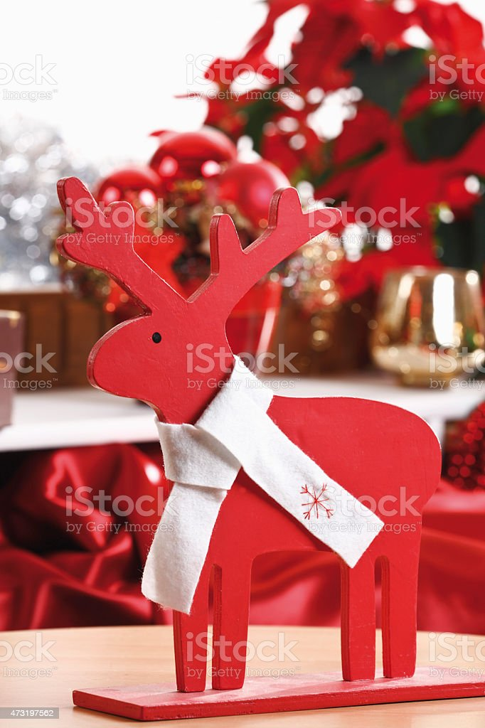 Christmas decoration, Wooden elk  figurine with white bow, close-up stock photo