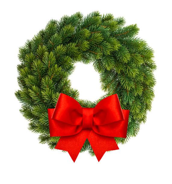 christmas decoration wreath red ribbon bow isolated white - wieniec zdjęcia i obrazy z banku zdjęć