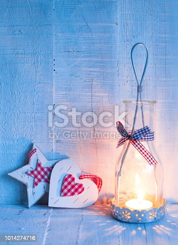 istock Christmas decorations  and   lantern at the  evening .  Toned image.  Focus on the heart 1014274716