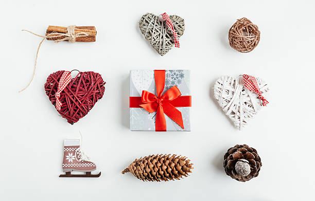Christmas decorations and objects for mock up template design. Christmas decorations and objects for mock up template design. Christmas gift box, christmas hearts, cinnamon, cones, ice skating View from above. Flat lay. Xmas decorations. overhead projector stock pictures, royalty-free photos & images