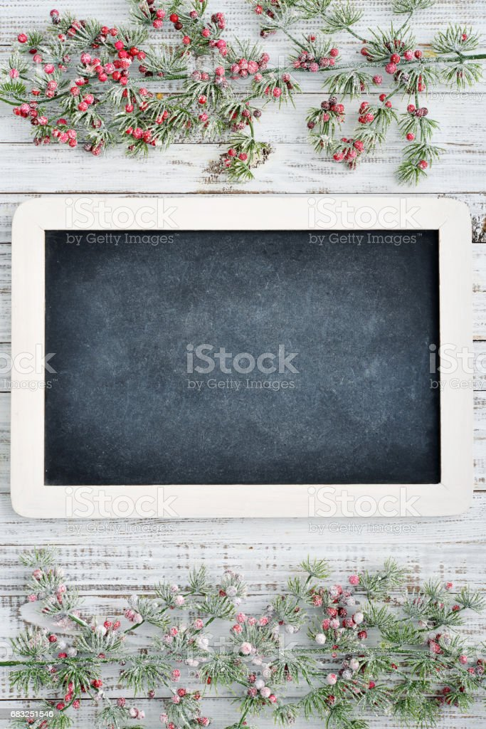 Christmas decorations and slate blackboard Lizenzfreies stock-foto