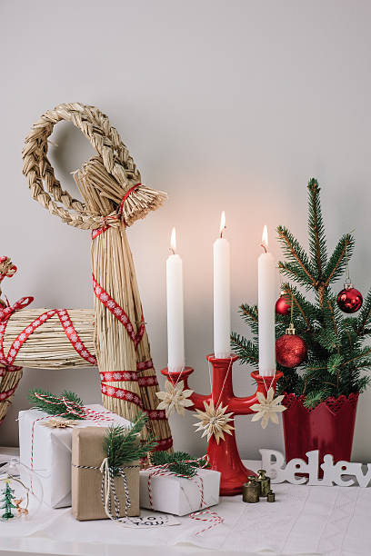 christmas decorations and wrapped gifts in candle light stock photo