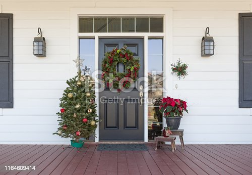 Christmas Decorations At Front Door of House.