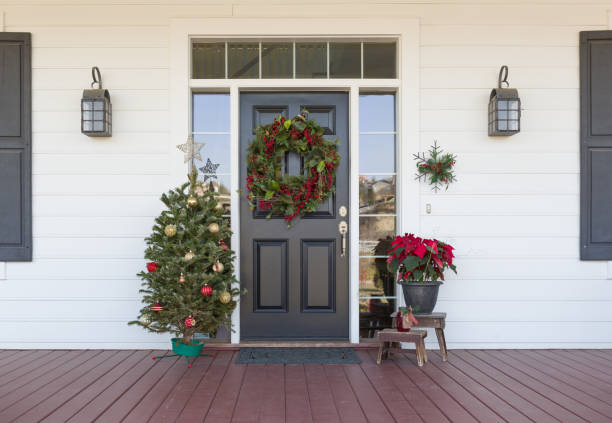 Christmas Decorations At Front Door of House Christmas Decorations At Front Door of House. front door stock pictures, royalty-free photos & images