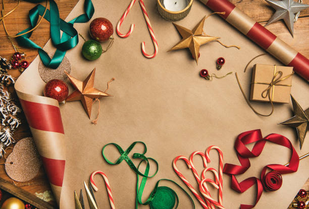christmas decorations, balls over wrapping paper, top view - avvolgere foto e immagini stock