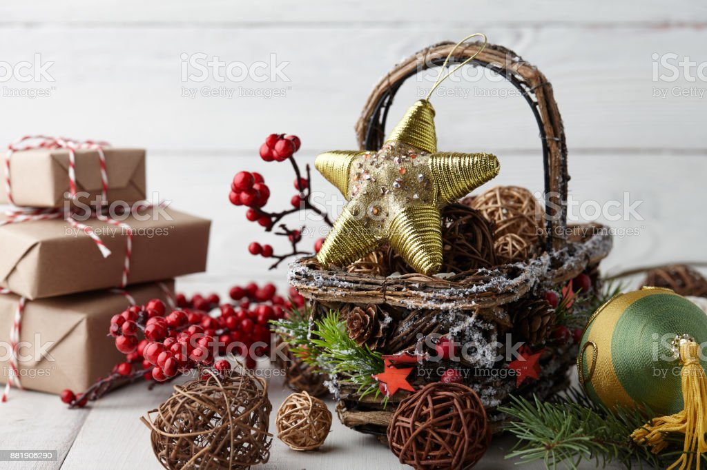 christmas decorations basket on white planks royalty free stock photo
