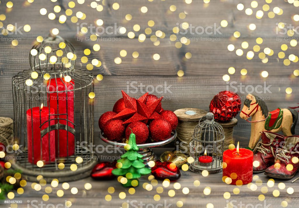 christmas decorations candles baubles stars rocking horse golden lights royalty free stock photo