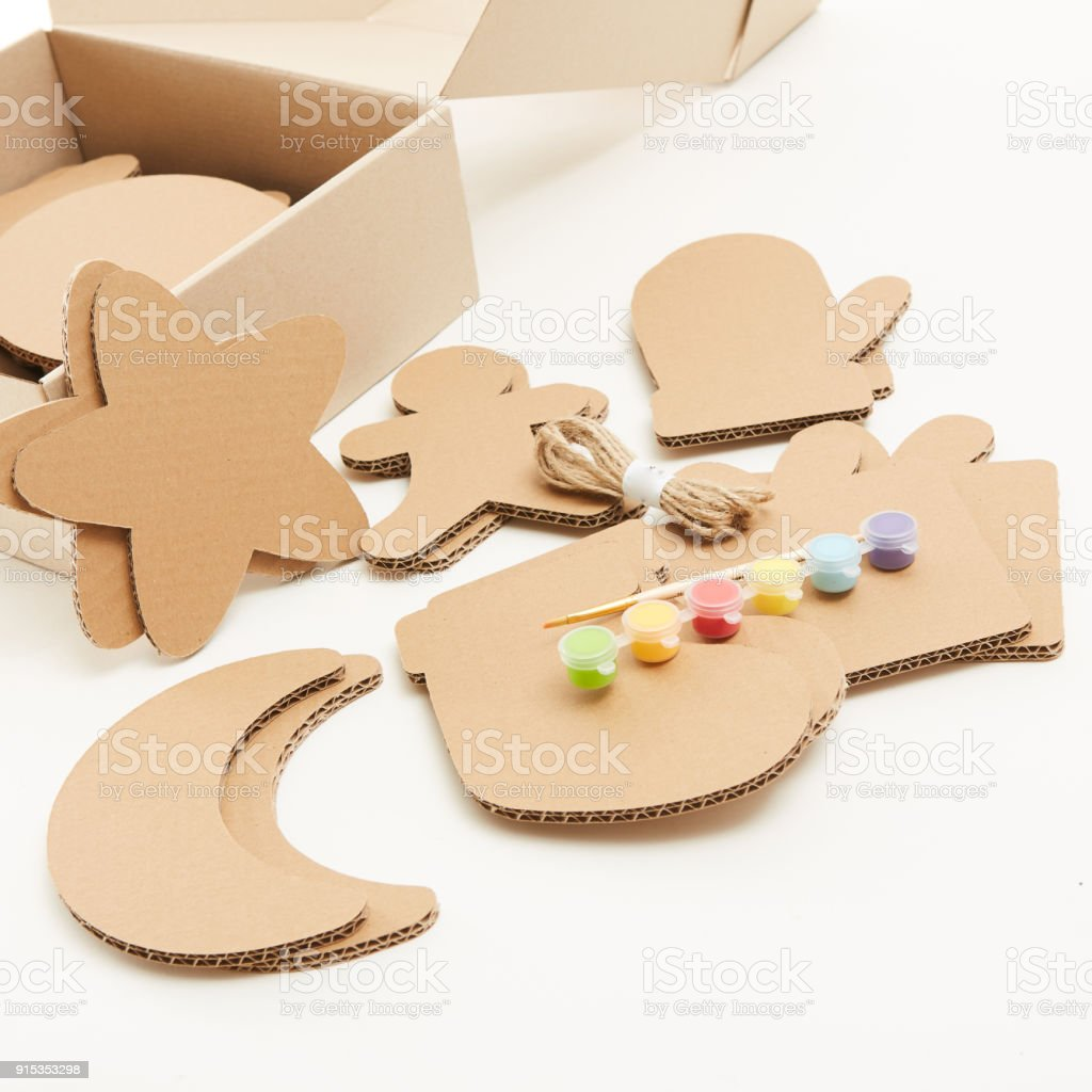 DIY christmas decorations from cardboard paper. Homemade Christmas ornament from reused paper. Craft ideas for kids. stock photo