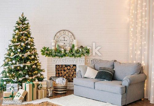 Christmas decorations and a garland on the tree with a home interior