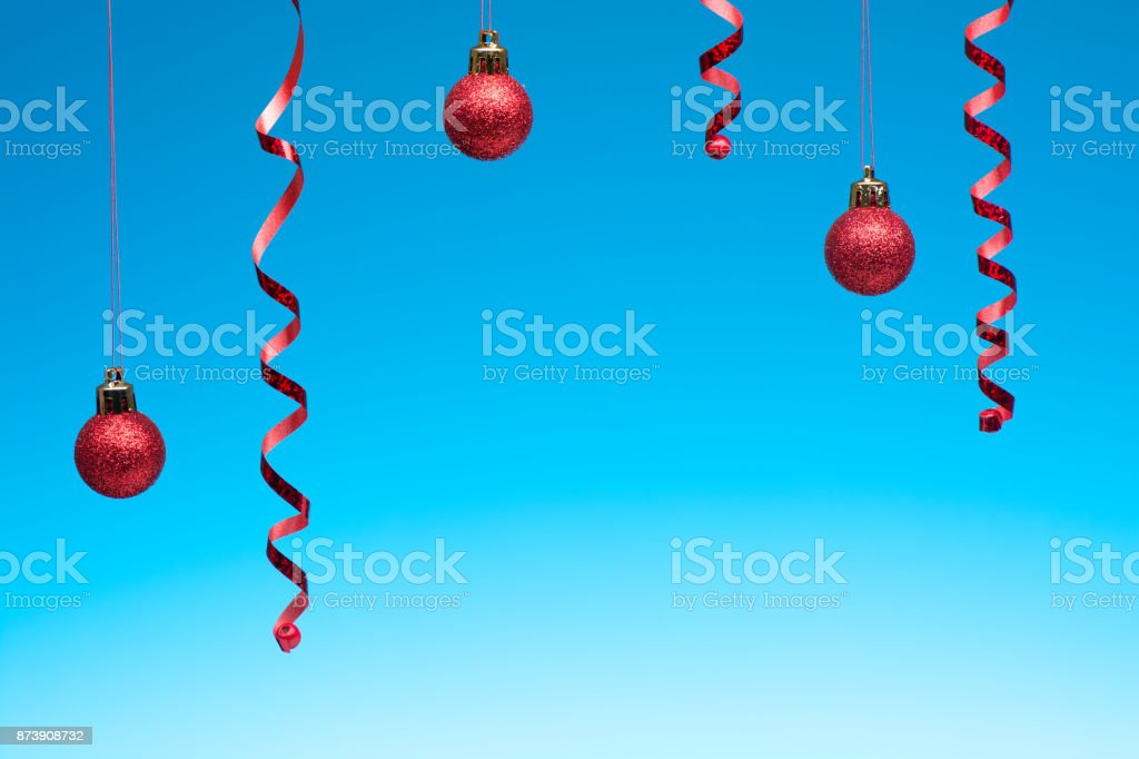 Christmas decorations hang on a blue background stock photo