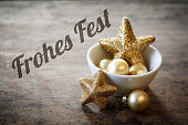 istock Christmas decorations in bowl, German wishes, Frohes Fest 493108212