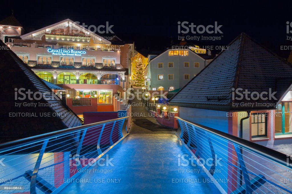 Christmas decorations in Ortisei bridge view Italy at night stock photo