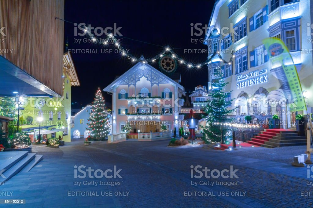Christmas decorations in Ortisei central plaza Italy at night stock photo