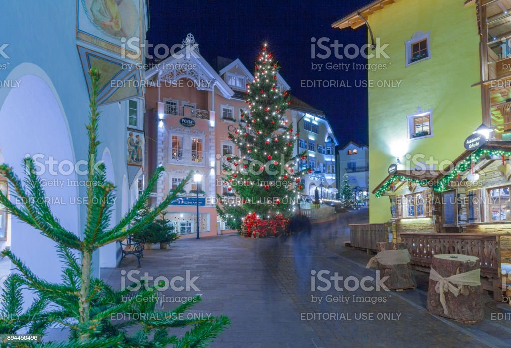 Christmas decorations in Ortisei with christams tree Italy at night stock photo