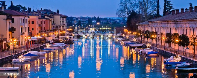Christmas decorations reflected in the channel. Peschiera del Garda, Lake Garda, Italy. Canon EOS 5D Mark II