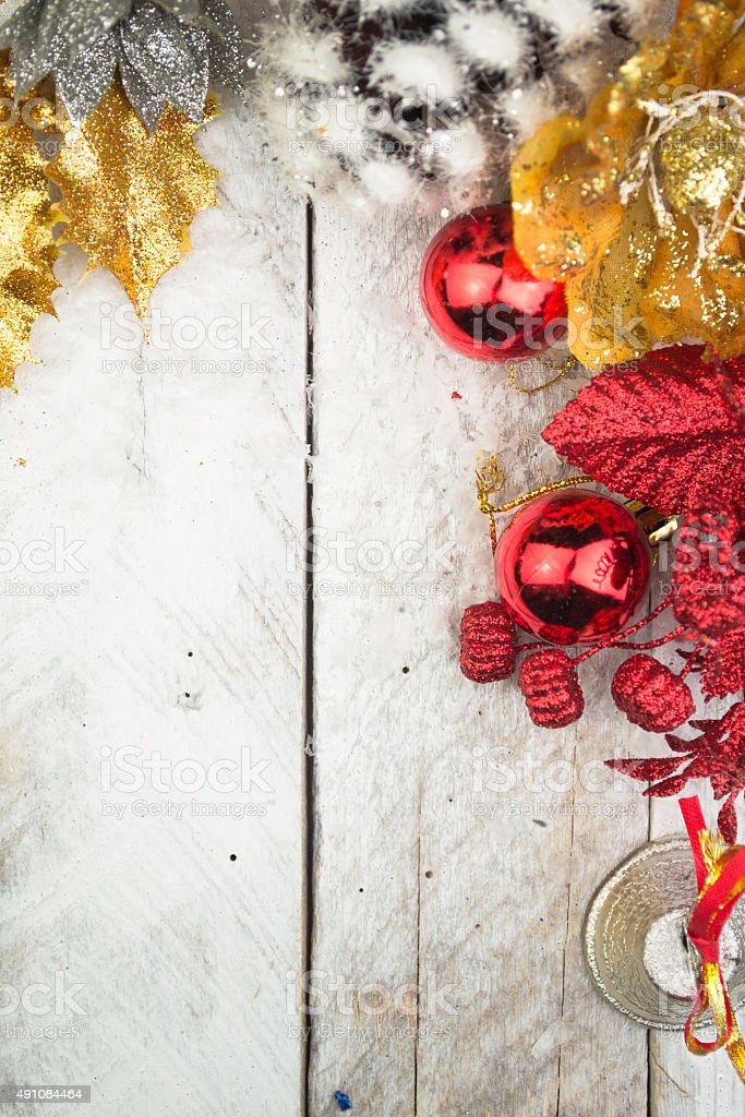 Christmas decorations in red and gold tone on wood stock photo