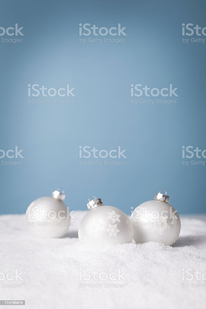 Christmas Decorations in Snow, With Turquoise Background royalty-free stock photo