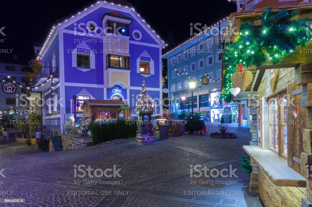Christmas decorations in streets Ortisei at night Italy stock photo