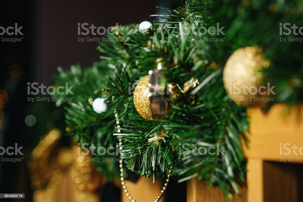 Christmas Decorations On A Wooden Fence Branches Of A Green