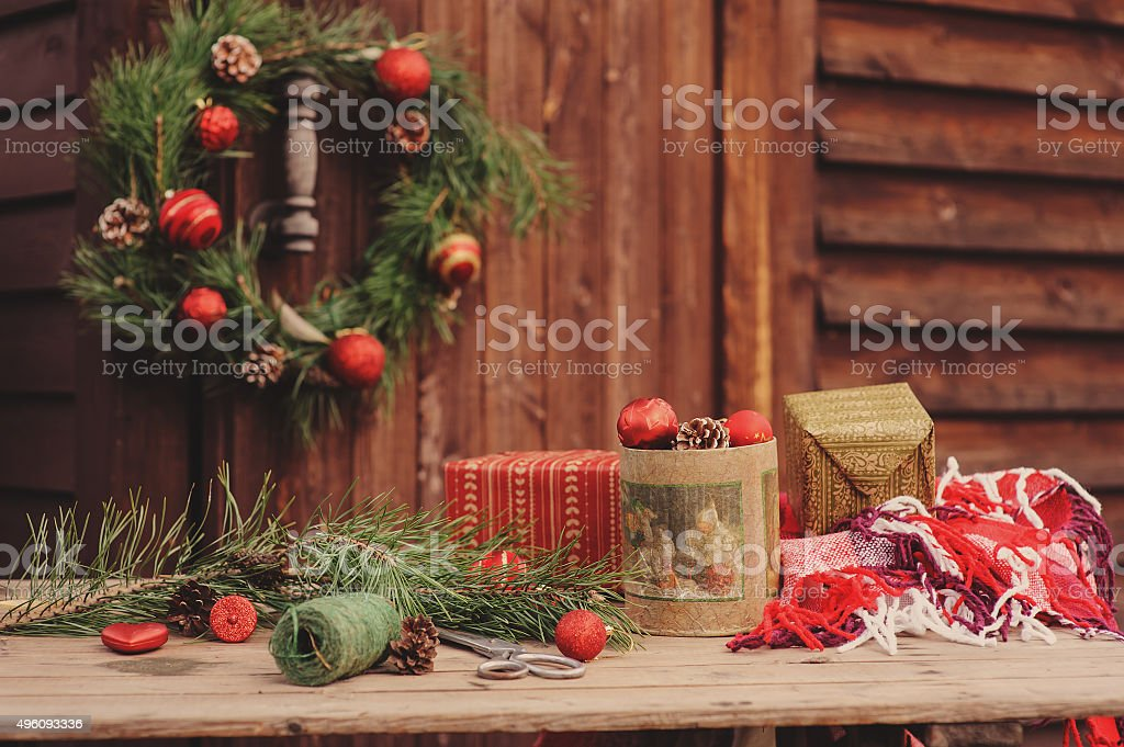 Christmas Decorations On Table At Cozy Wooden Country House Stock