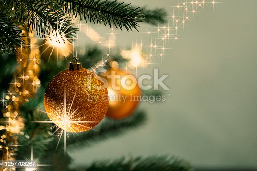 istock Christmas decorations on the branches fir with sparkles 1257703267