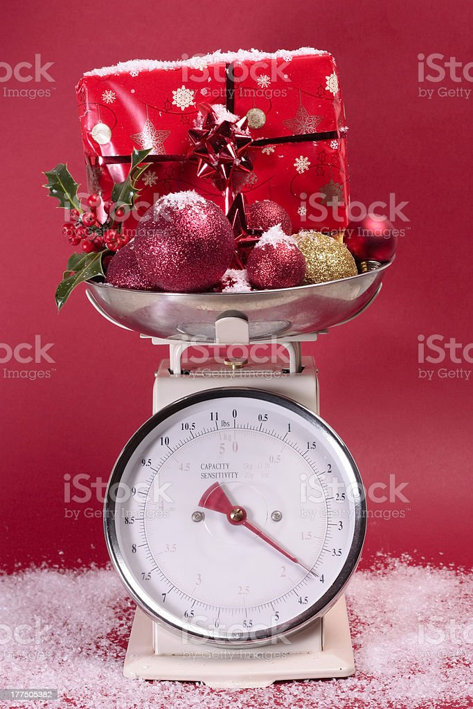 Christmas decorations on weighing sclaes stock photo